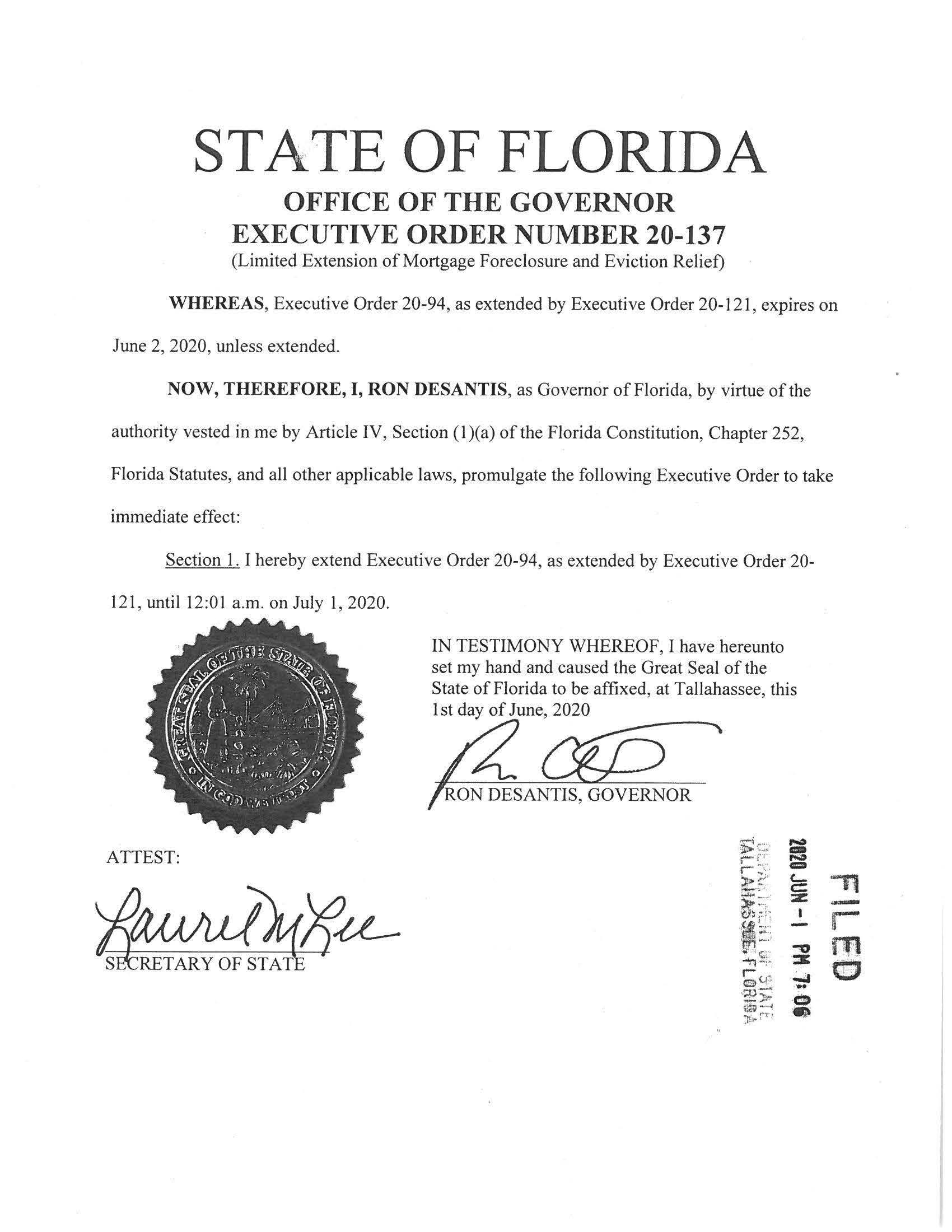 Image of the executive order, black type on a white page, over the signatures of Gov. Ron DeSantis a